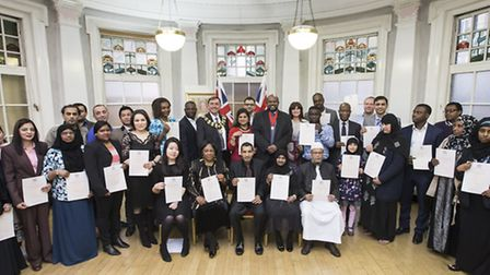 Sir Robin Wales and Cllr Paul Sathianesan with the new British citizens