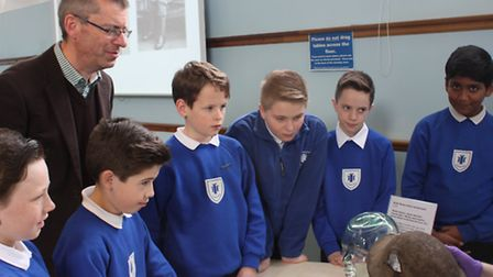Cllr Andrew Curtin and children from Towers Junior School looking at the museum's First World War ar