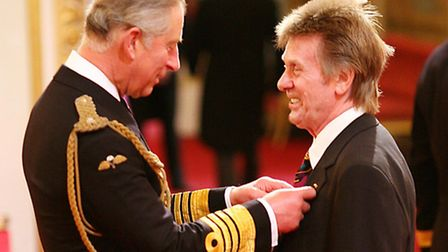 Veteran rock guitarist Joe Brown receives his MBE for services for music from the Prince of Wales at