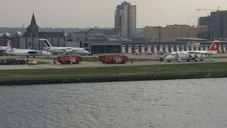 Emergency services tend to the downed Swiss International plane at London City Airport. Pic: Twitter