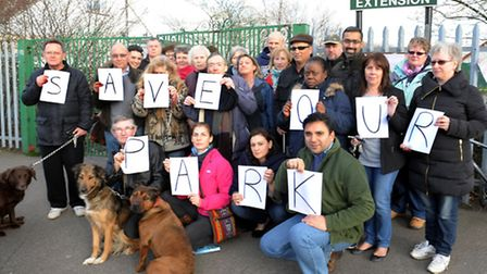 Cllr Ali Hai (front row, far right) and residents at a previous protest over the park extension's fu