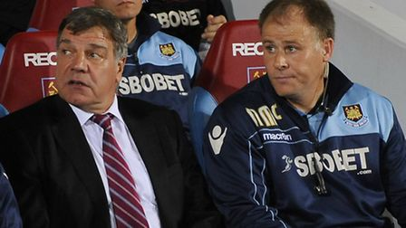 West Ham United manager Sam Allardyce (left) with assistant manager Neil McDonald in the dugout