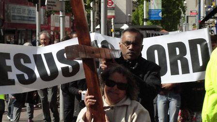 A cross and signs were carried. Picture: Peter Musgrave.