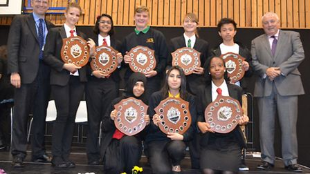 Year 11 students with headteacher Anthony Wilson, left, and chair of governors Dave Wood, right.