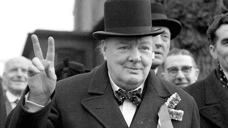 Winston Churchill give his 'victory' sign as he made a general election polling day tour of his cons