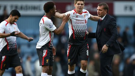 Liverpool manager Brendan Rodgers (right), Raheem Sterling (left) and Steven Gerrard celebrate victo