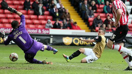 Dean Cox slots under Mark Howard to give Orient the lead. Pic by Simon O'Connor