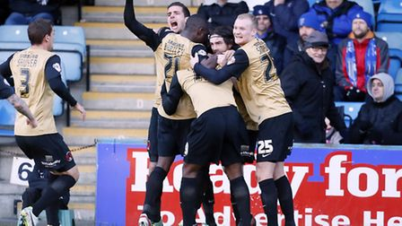 Yohann Lasimant is mobbed after his winner at Gillingham. Pic by Simon O'Connor