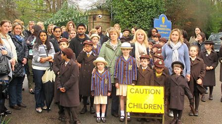 Parents and pupils protesting outside the school. Picture: Jan West