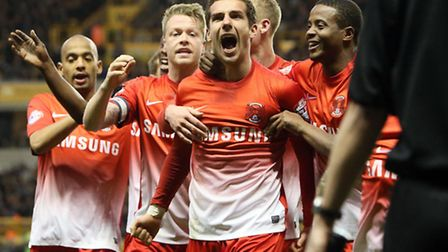 Mathieu Baudry celebrates his equaliser against Wolves in the reverse game at Molineux. Pic by Simon