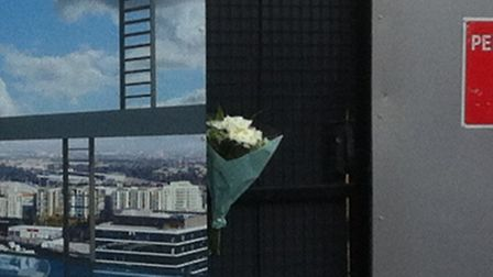 Flowers left on the gate of the construction site