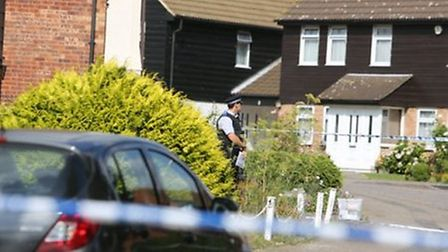 Police outside the victim's home.
