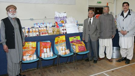 Bashir Chaudhry, Ali Younis, Mubarak Ali and Lal Gujar with the food collection. Photo credit: Steve