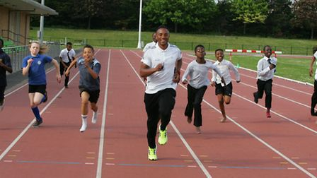 International sprinter Aidan Syers with youngsters on the Met Track programme