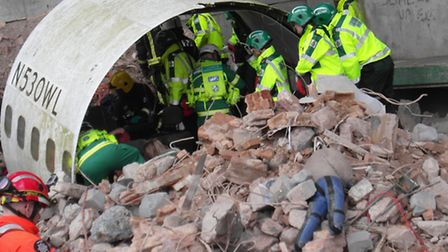 Passengers trapped in the fuselage are assessed by paramedics