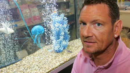 Aquatic centre owner Kevin Shaw with some of his fish tanks