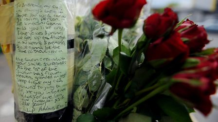 Floral tributes on Woodford Road where Andreas Elias was killed on Sunday Photo: David Mirzoeff