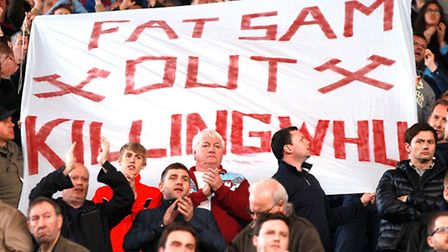 West Ham United's fans hold a protest banner against manager Sam Allardyce at The Hawthorns