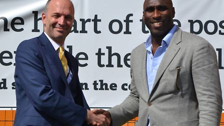 Headteacher Anthony Wilson with Sol Campbell