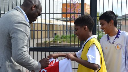 Sol Campbell signs autographs for pupils