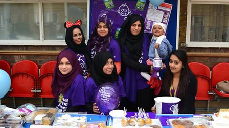 Some of the students who took part in the fundraiser are pictured with Surraiya-Aana who has been tr