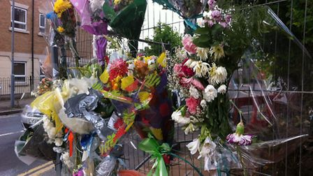 Floral tributes at the scene of the crash at the junction between Kenwood Gardens and Cranbrook Road