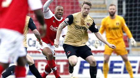 Orient skipper Nathan Clarke under pressure from Rotherham's Wes Thomas. Pic: Simon O'Connor