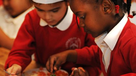Year 2 pupils from Poppy Class take part in a cookery class at Las Iguanas restaurant Photo: Davi