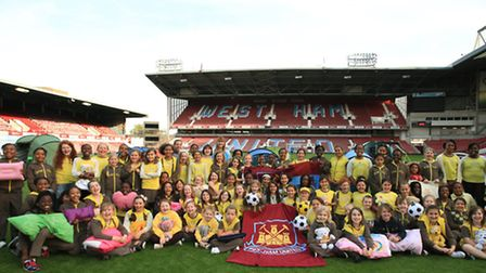 Brownies gather together in a sleepover at West Ham United's Boleyn ground.