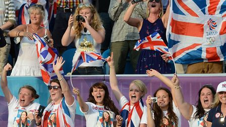 Team GB supporters cheer during the London 2012 Olympic Games. Picture: John Giles/PA Wire