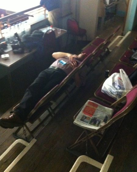A journalist takes advantage of a break between results to get some rest. Photo credit: Harry Kemble