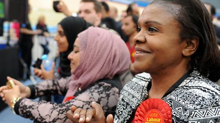 Labour candidate Aleen Alarice watches Sir Robin Wales, Mayor of Newham speak after he is re-elected