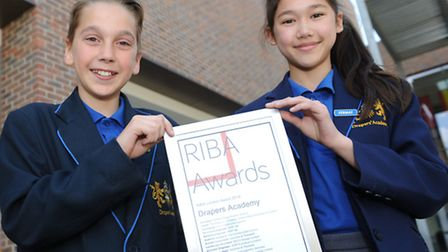 Matas Kardokas, 11, and Jessica Scott, 11, hold an certificate from the Royal Institute of British A