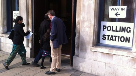 Voters make their way to the polling station at the Old Town Hall, Stratford