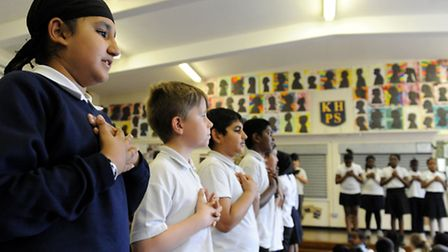 Pupils at Keir Hardie School take part in a performance during an assembly to mark the school reloca