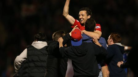 Leyton Orient's David Mooney is mobbed by the fans at the end of their play-off semi-final win over