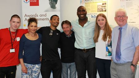 Sol Campbell with Caritas Anchor House staff and residents