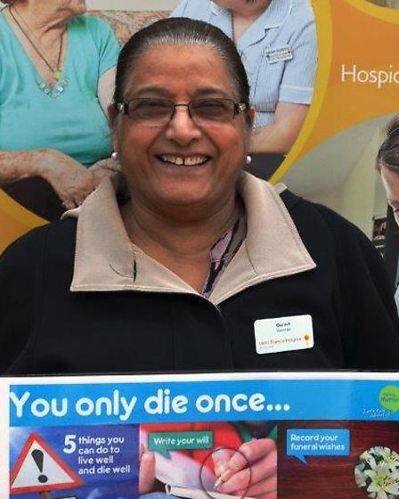 Volunteer Gurmit Mahil spreading the hospice message at an information stand held recently at King G