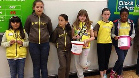 Beckton Brownies help out in Asda