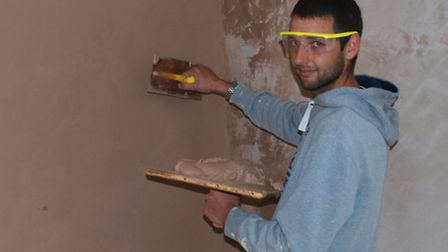 Harry Comb, 25, is now in full-time employment after finishing his plastering course