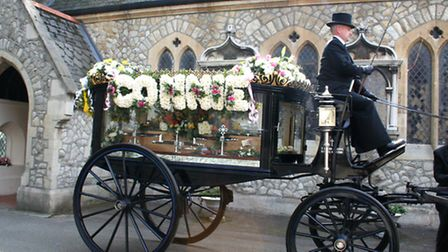 Connie's hearse arriving at the cemetery