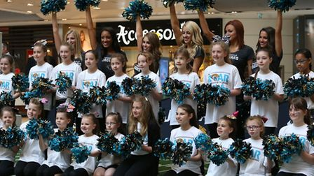 Kerri Soan, middle row second right and Stephanie Hedges, middle row, third right, with the other lu
