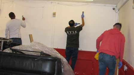 Volunteers painting the clubhouse