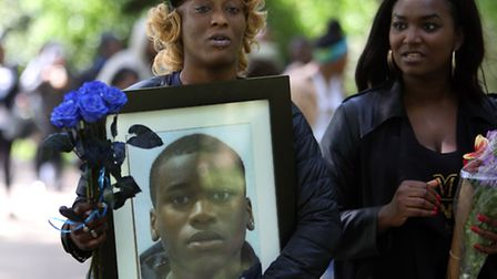Mourners carried a framed portrait of Champion
