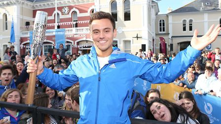 Tom Daley carries the Commonwealth Games baton back on to British soil. Pic: Chris Radburn for Glasg