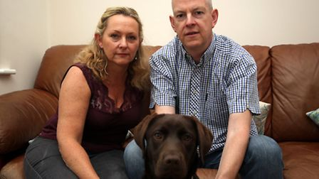 Couple Colin Linton and Sarah Preddy with their dog Molly. They discovered a fox in their spare bedr