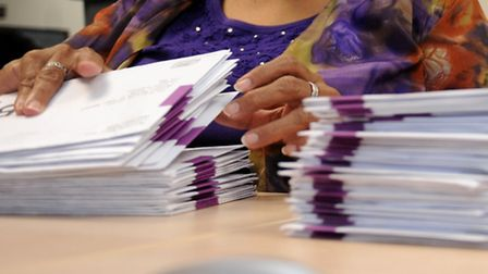 Election officers sort through postal votes ahead of the May 22 elections