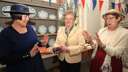 Barbara Elliot, left, and sister Pat watch out as the mayor of Redbridge, Cllr Felicity Banks, hold