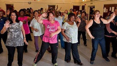Pictured at the front of the dance class are several women, including Maria (right) and Feroza (firs