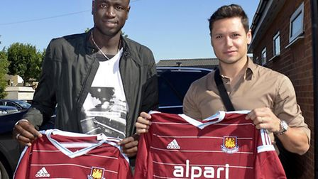 Cheikhou Kouyate and Mauro Zarate arrive at Chadwell Heath for the first day of training ahead of th